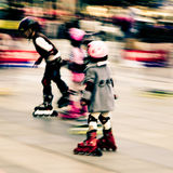 Child playing rollerblade Stock Images