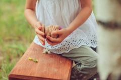 Child playing with salt dough and making cakes Royalty Free Stock Image