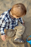 Child Playing in the Sand Royalty Free Stock Photography