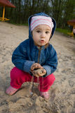 Child playing in sand. Little girl playing in sand on river back Stock Photos