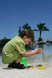 Child playing in sand. On beach Stock Photos