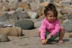 Child Playing in the Sand. Toddler playing at the beach Royalty Free Stock Photo