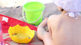 Child Playing with Sand stock footage