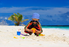 Child playing on sand beach Stock Image