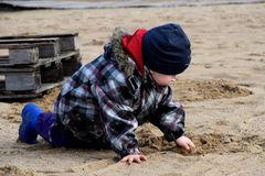 Child playing in the sand Royalty Free Stock Photo