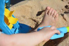 Child playing in the sand royalty free stock image