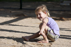 Child playing with sand on the playground Stock Photography