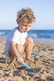 Child playing with the sand Stock Image