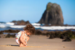 Child Playing In The Sand Stock Images