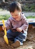 Child playing in sandbox Royalty Free Stock Image