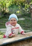 Child playing in sandbox Royalty Free Stock Photo