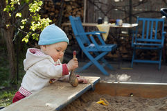 Child playing in sandbox Stock Photo