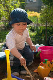 Child playing in sandbox Stock Photos