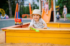 Child playing in the sandbox Royalty Free Stock Photos