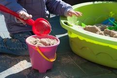 Child playing in sandbox. Little girl playing in sandbox Stock Images