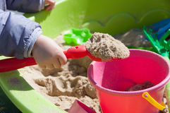 Child playing in sandbox Stock Photo