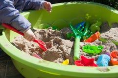 Child playing in sandbox. Little girl playing in sandbox Stock Photography