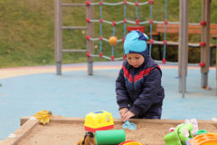 Child playing in sandbox Stock Photography