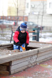 Child playing in the sandbox Royalty Free Stock Photography
