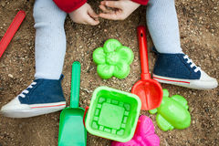 Child playing in the sandbox shovel Royalty Free Stock Images