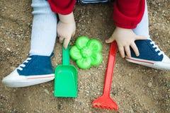 Child playing in the sandbox shovel Stock Image
