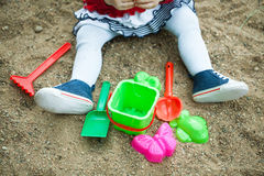 Child playing in the sandbox shovel Royalty Free Stock Photo