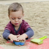 Child playing in sandpit Royalty Free Stock Photography