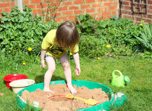 Child playing in a sandpit. Royalty Free Stock Image