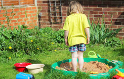 Child playing in a sandpit. Stock Photography