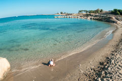 Child playing on sandy beach of Mediterranean sea Stock Photography