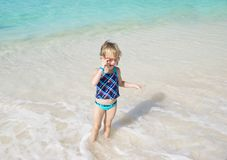 Child playing in the sea Stock Image