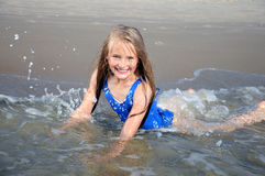 Child playing in sea Stock Photos