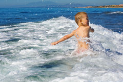 Child playing in the sea Royalty Free Stock Photography
