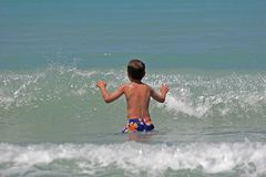 Child playing in sea Stock Photo