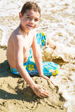 Child playing on the seashore Royalty Free Stock Photos