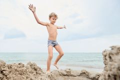 Child playing on the seashore royalty free stock photo