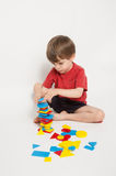 Child Playing with Shape Blocks Stock Photo