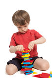 Child Playing with Shape Blocks stock images