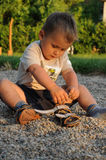 Child playing with shoes Stock Photo