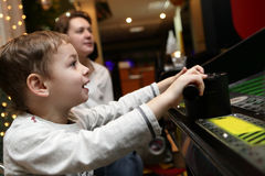 Child playing shooting game Stock Photo