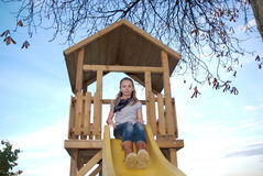 Child playing at slide Royalty Free Stock Images