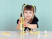 Child playing with small toys at table Royalty Free Stock Photography