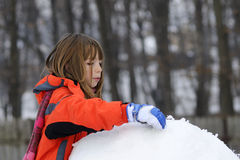 Child playing with snow Royalty Free Stock Photos