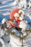 Child playing in snow Royalty Free Stock Photos