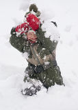 Child playing in snow Stock Photography