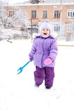 Child playing with snow Royalty Free Stock Images