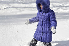 Child in winter. Child playing in the snow Royalty Free Stock Image