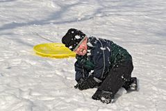 Child playing in snow Royalty Free Stock Photography