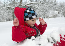 Child playing in snow Royalty Free Stock Photo