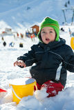 Child playing on the snow Royalty Free Stock Photography